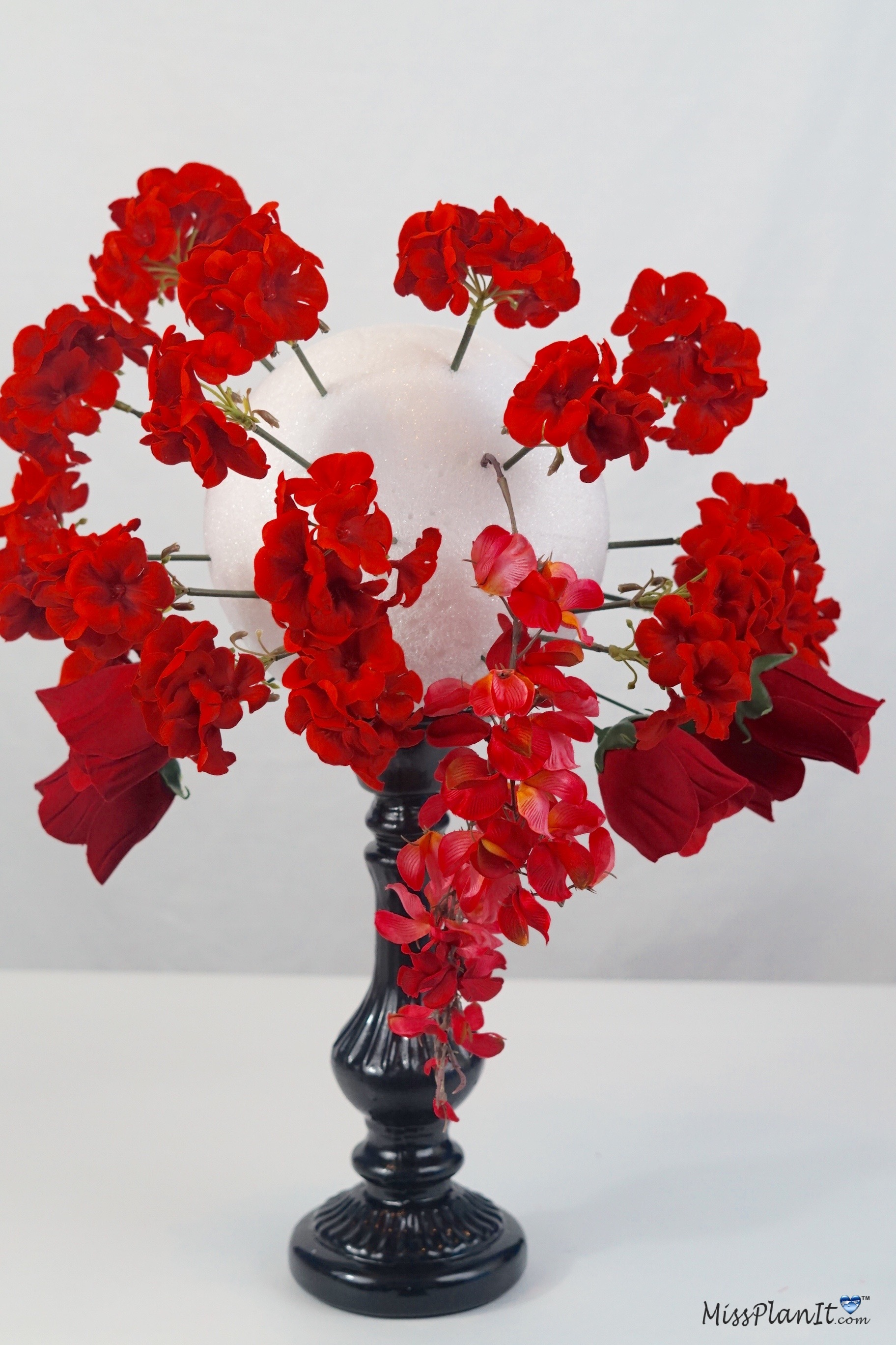 Tall rose garden candlestick wedding centerpiece