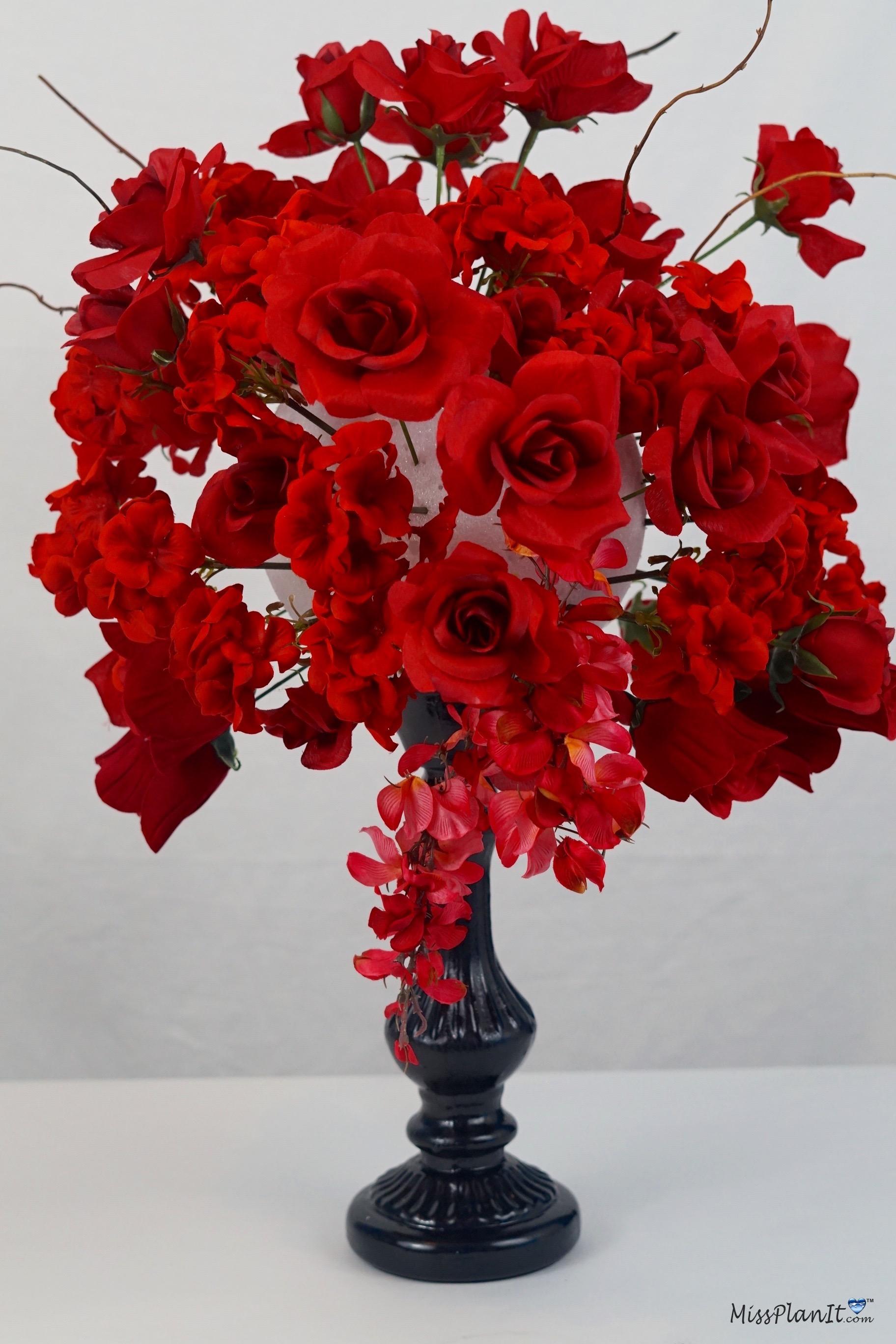 Tall rose garden candlestick wedding centerpiece