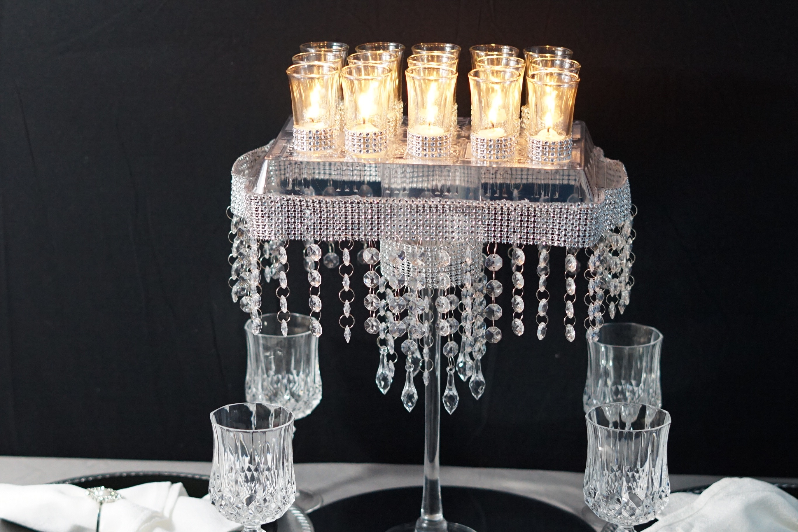 Diy candle glam wedding centerpiece lets glam it up this week with our diy candle glam wedding centerpiece adorned with gems rhinestone trim and candles this blinged out table decor is junglespirit Images