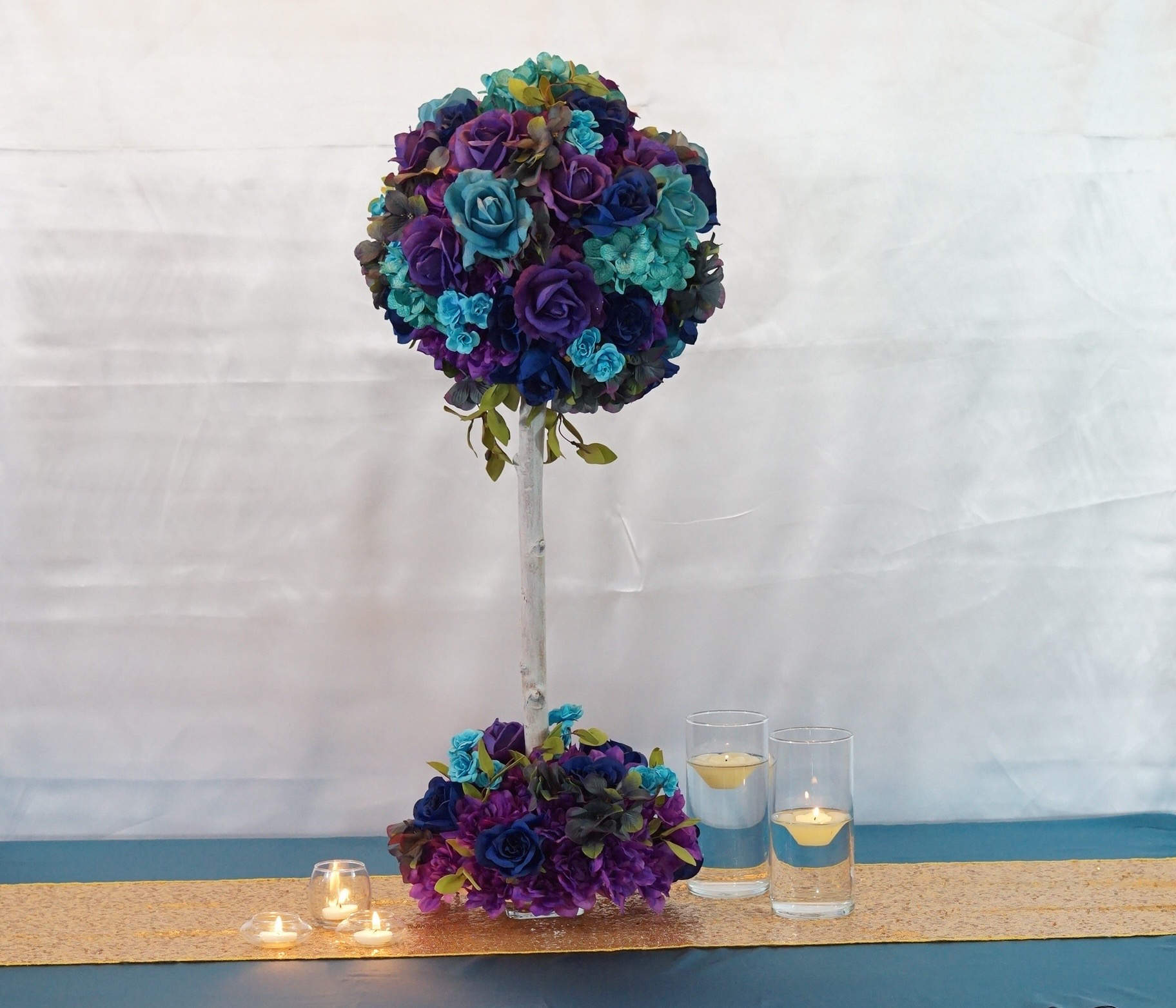 Diy Peacock Inspired Blue And Purple Wedding Centerpiece
